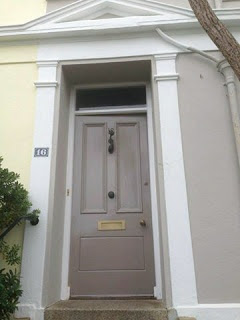Front door is Farrow and Ball Charleston Gray with Elephants Breath house exterior walls.