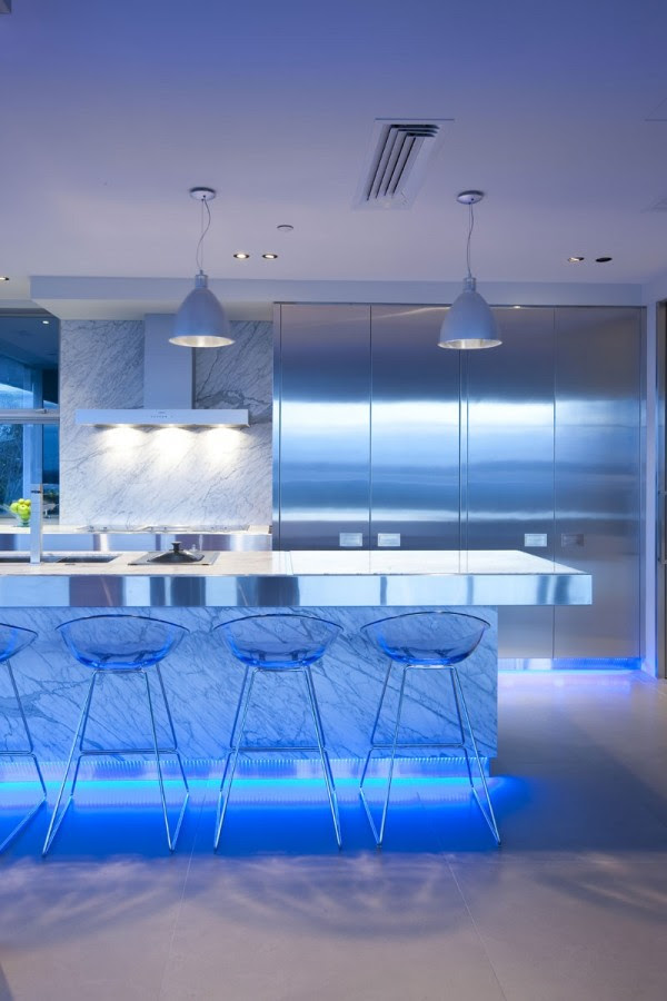 The designer chose blue LED lighting to infuse this modern kitchen with almost underwater-like ambiance.