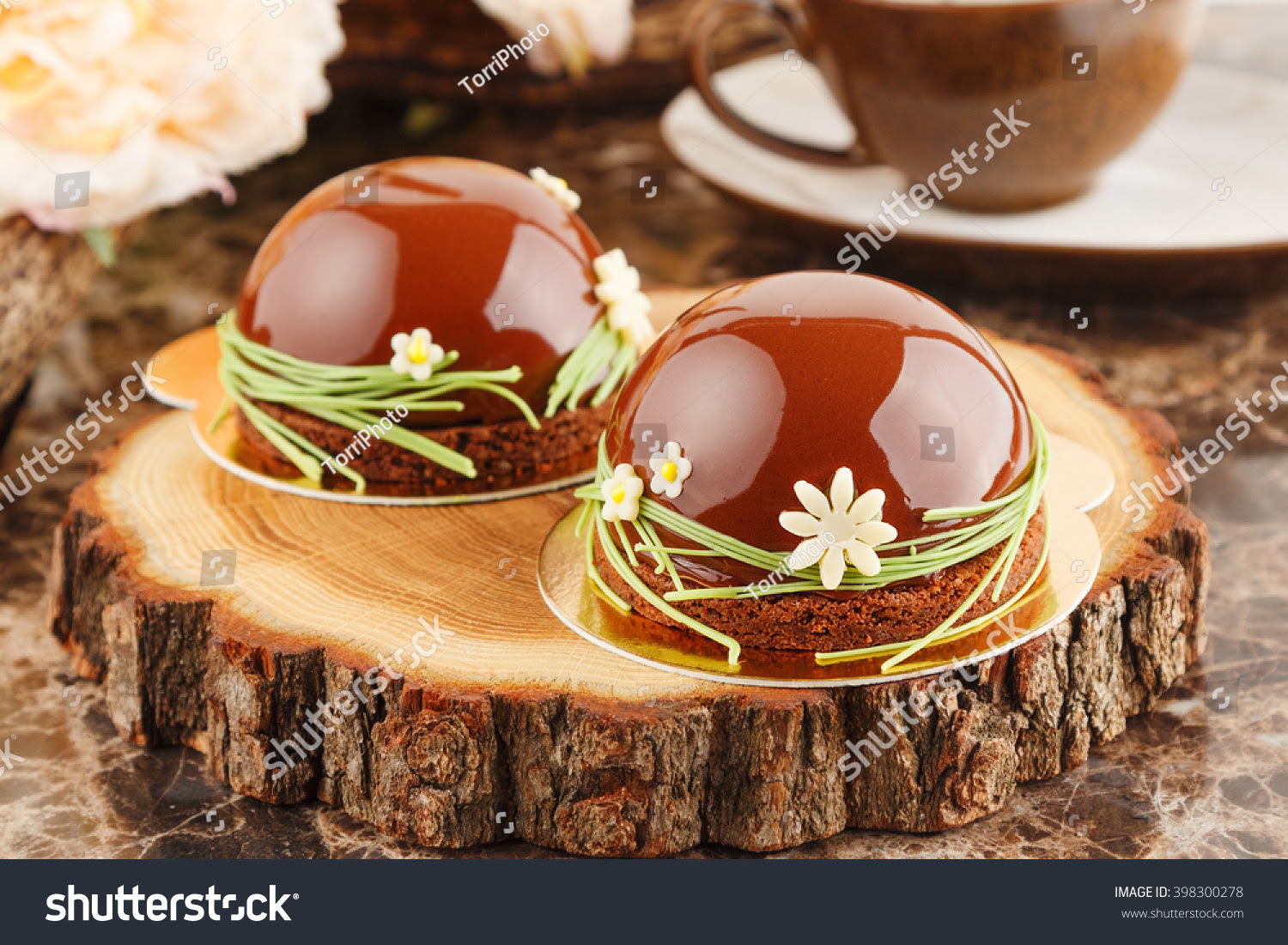 http://www.shutterstock.com/pic-398300278/stock-photo-french-mousse-cake-covered-with-chocolate-glaze-on-rustic-brown-background-modern-european-cake.html