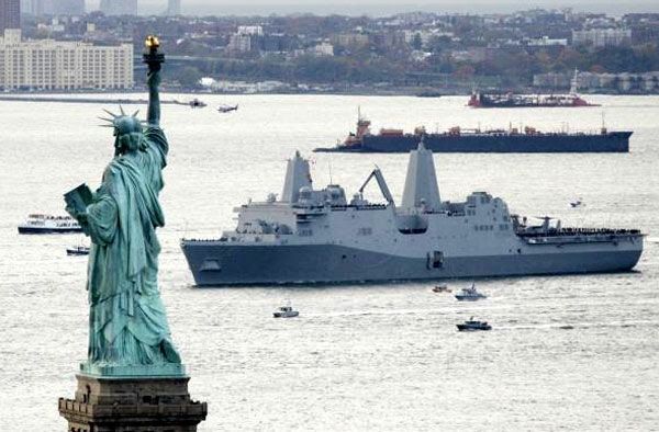 The USS NEW YORK approaches the Statue of Liberty after arriving at its namesake state on November 2, 2009.