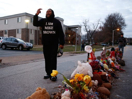 A protester in a sweatshirt that reads 'I Am Mike Brown'