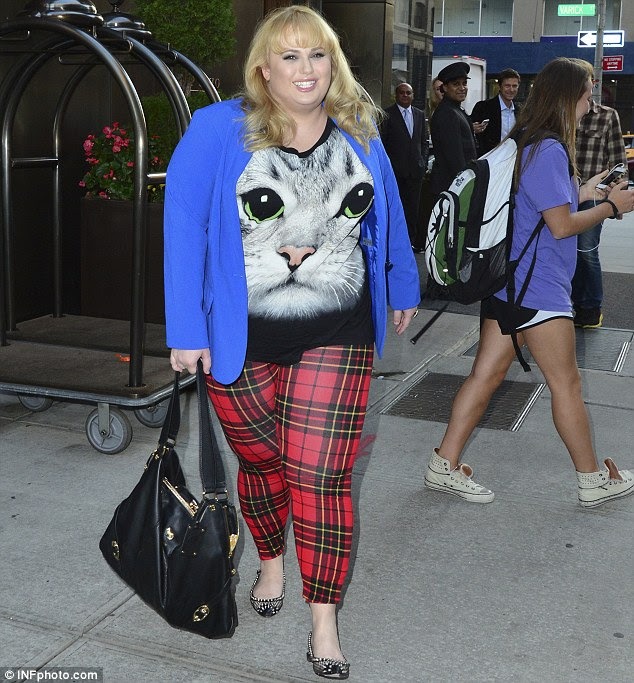 The cat's meow: The confident actress donned a unique style of her own in a blue blazer, an oversized T-shirt featuring a giant cat print and red plaid leggings