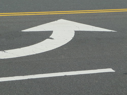 Turn sign painted on road
