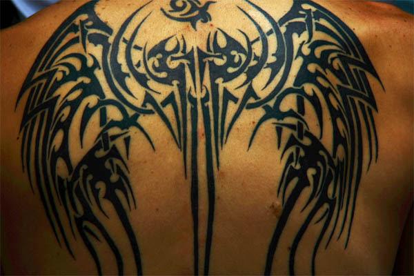 Black Tribal Cross And Wings Tattoo