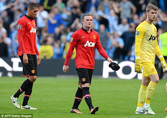 Trudging off: Rooney, Chris Smalling and David de Gea leave the pitch dejected at the end