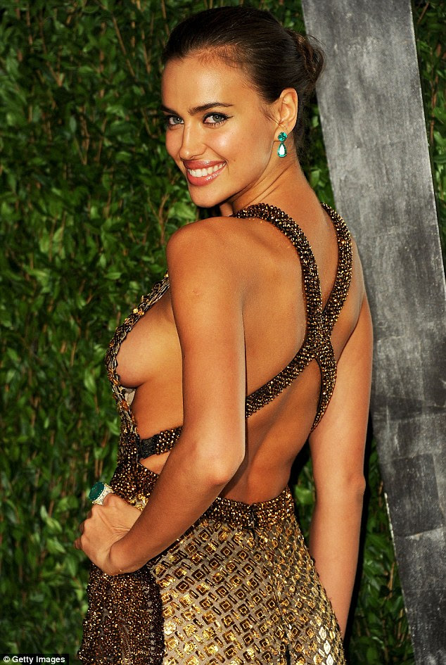 Rather revealing: Irina Shayk showed off some 'side-boob' as she arrived at the Vanity Fair Oscar Party in West Hollywood last night
