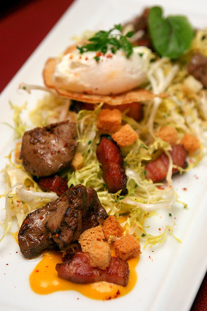 Salade Lyonnaise - Frisee salad, chicken livers, bacon, poached egg, croutons, mustard and carrot dressing