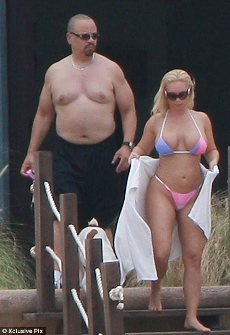 Heavyweight star: Rapper Ice T appears to have piled on the pounds in recent years and was seen letting it hang out as he enjoyed a day at the beach with his wife
