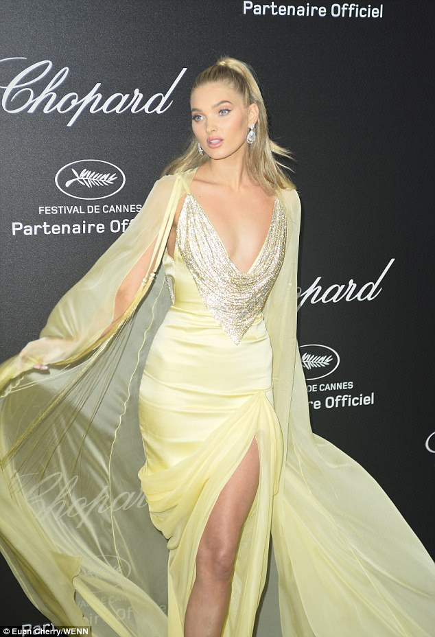 Oops:Clad in a billowing yellow gown, the 29-year-old model was playing around with the billowing cape detailing when she accidentally tangled her heel in the swathes of fabric
