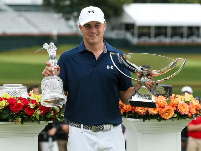 Jordan Spieth with FedExCup and Tour Championship trophies