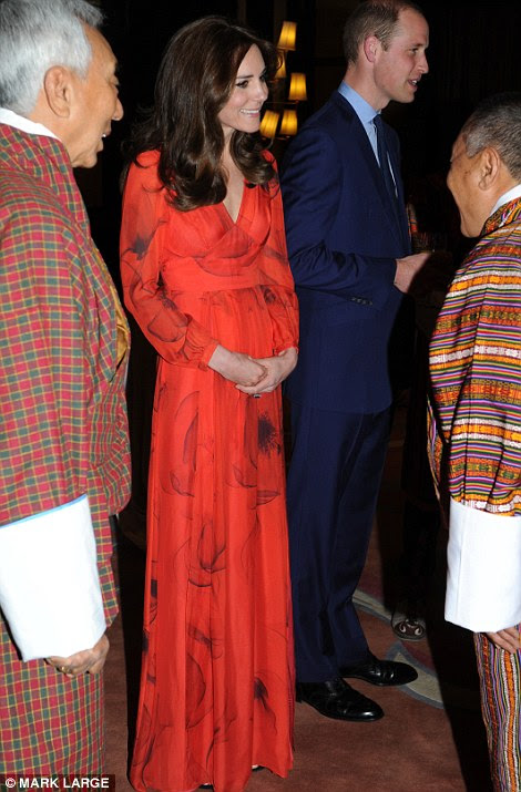 Glamour: Kate swapped her skinny jeans and worn boots for the radiant £745 dress, while Prince William sported a navy blue suit
