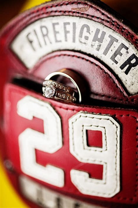Wedding ring shot on his helmet.. Instead of ring pillow