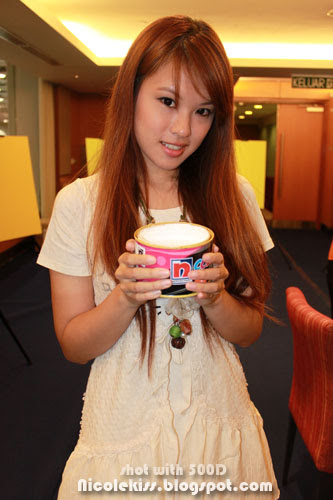 nicole holding a nippon white paint