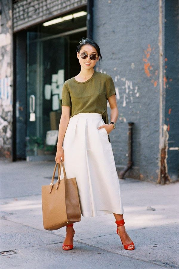 Le Fashion Blog New York Fashion Week Street Style Margaret Zhang Shine By Three Complementary Colors And Cutlottes Via Vanessa Jackman Front View Round Tort Sunglasses Low Bun Chignon Hair Olive Green Side Split Shirt Tan Tote Bag High Waisted Off White Culottes Cropped Wide Leg Pants Trousers Bright Red Ankle Wrap Heeled Sandals Heels 2 photo Le-Fashion-Blog-New-York-Fashion-Street-Style-Margaret-Zhang-Shine-By-Three-Complementary-Colors-And-Cutlottes-Via-Vanessa-Jackman-2.jpg