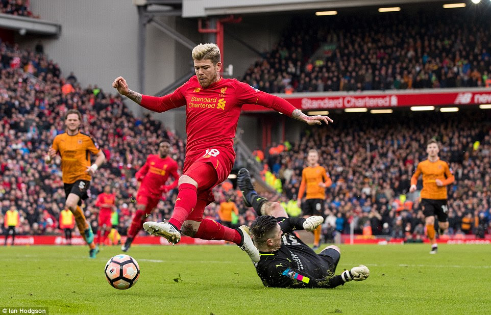 Alberto Moreno takes the ball past goalkeeper Harry Burgoyne but runs the ball over the goal line in the process