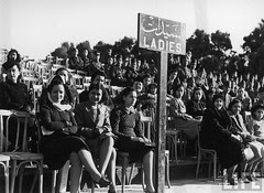 women sitting at Heliopolis Athletic Field as they watch a soccer match between the Medical & Artillery Units of the Egyptian Army which the King attended.