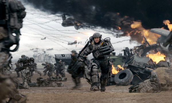 Cage and his fellow soldiers battle against Mimics on a French beach in EDGE OF TOMORROW.