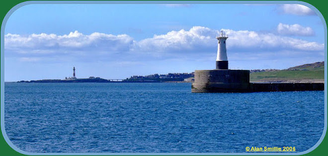 Peterhead's South Breakwater with Buchanness Lighthouse in the background.