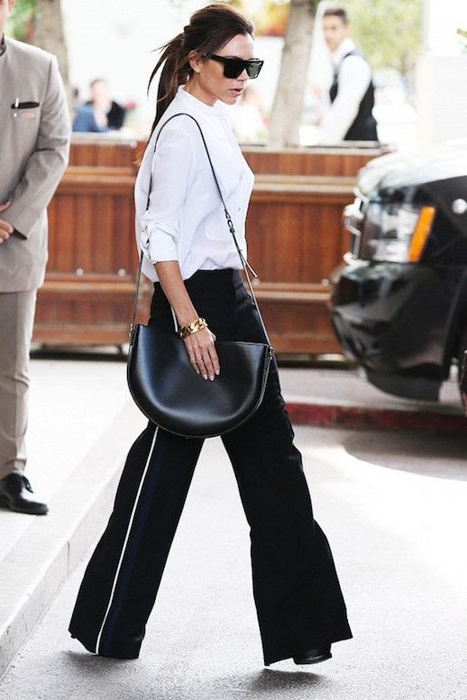 Le Fashion Blog Celebrity Style Victoria Beckham Sunglasses White Tuxedo Shirt Leather Shoulder Bag Side Stripe Wide Leg Pants Via Who What Wear