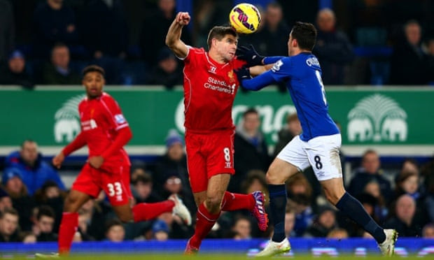 Steven Gerrard tussles with Bryan Oviedo of Everton.