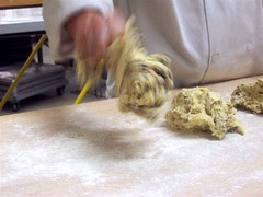 Throwing scone dough onto the bench.
