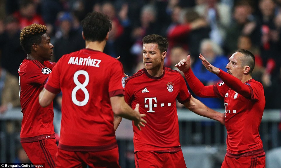 Xabi Alonso (centre) celebrates with his team-mates after levelling the scores on aggregate during the second leg in Munich