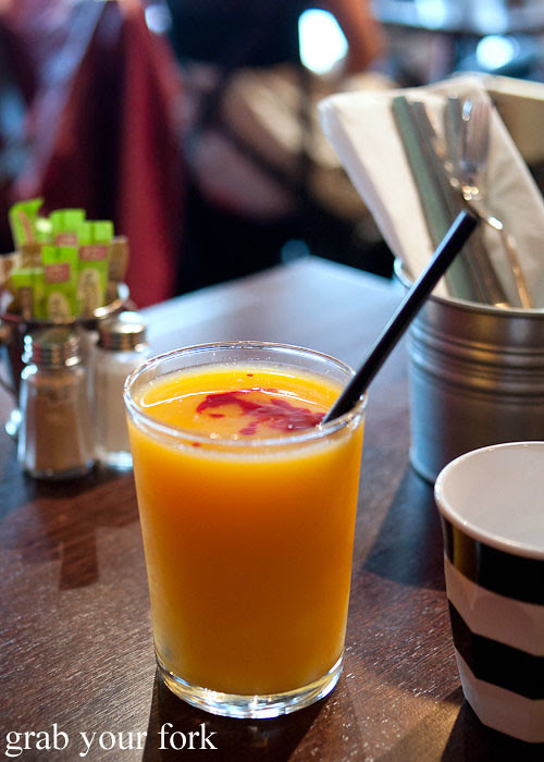 fresh orange juice with raspberry coulis at the hub house diner dulwich hill