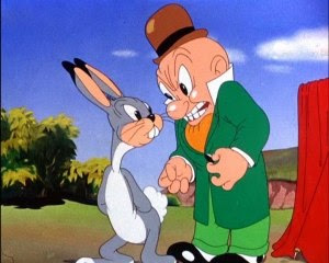 Elmer Fudd is annoyed by the prototype Bugs in...