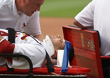 Yadier Molina suffered a mild concussion on Ju...
