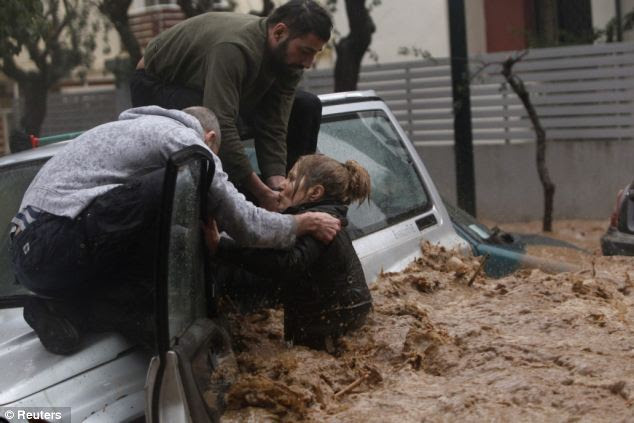Flash floods: More than a metre of water gushed along the road in the city's northern suburb