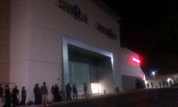 A line gathers outside the local Toys'R'Us store for the midnight opening of 'Force Friday II'...on August 31, 2017.