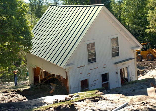 FILE - In this file photo taken Aug. 30, 2011, a house rests in mud after it was destroyed by Hurricane Irene Sunday in Pittsfield, Vt. Many homeowners who suffered damage from Tropical Storm Irene wi
