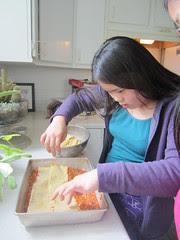 Sophia Layering the Lasagna