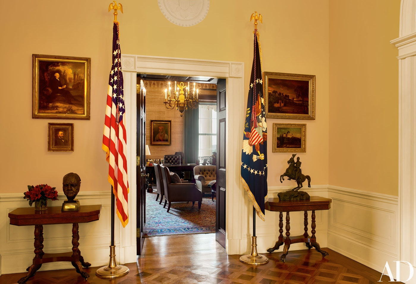 At the Treaty Room entrance, Sir Jacob Epstein's 1946 bust of Winston Churchill stands on a circa-1810 New York card table.