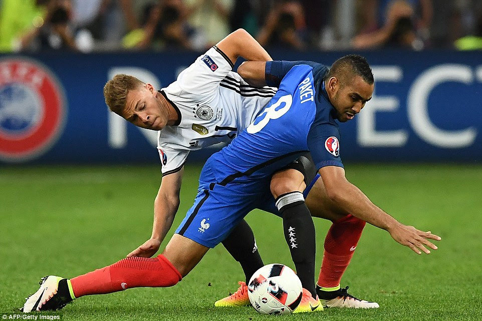 Payet goes to ground under the challenge of Kroos in midfield as France huffed and puffed early on