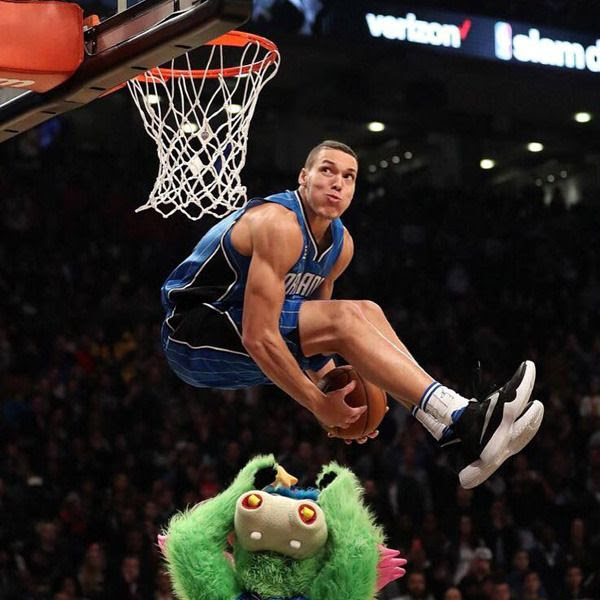The Orlando Magic's Aaron Gordon leaps over team mascot Stuff the Magic Dragon during the 2016 NBA Slam Dunk Contest...on February 13, 2016.