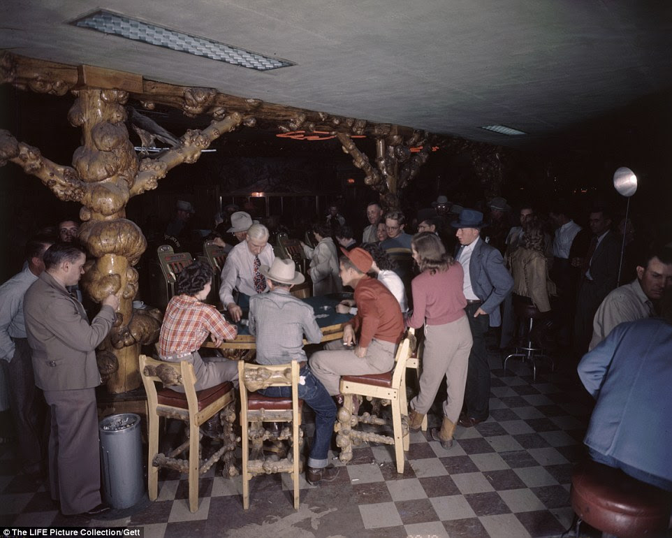 Howdy boys: A room full of patrons gambling at The Cowboy Bar in Jackson Hole in Wyoming, after flocking from the city for a break