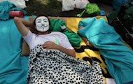Protesters sleep in Kugulu Park in Ankara, Turkey, Saturday, June 8, 2013. A senior European Union official, the EU enlargement commissioner Stefan Fule on Friday, criticized Turkish police's harsh crackdown on protesters in the last week. Fule stated Turkey should aspire to the highest standards of democracy.(AP Photo/Burhan Ozbilici)
