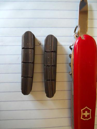 Metal flecks in bicycle brake pads