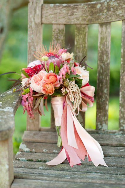 Pink-Peach-and-Purple-Bouquet-With-Ribbons-on-Rustic-Chair-598x900