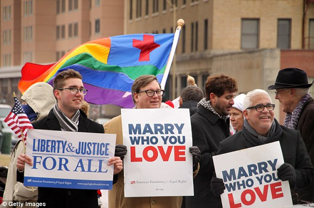 Demonstrators protest for equal marriage outside the Walter E. Hoffman U.S. Courthouse in Norfolk, Virginia, which has overturned a ban on the custom