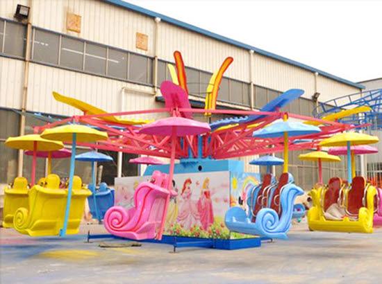 Amusement park kiddie parachute rides with snow white theme