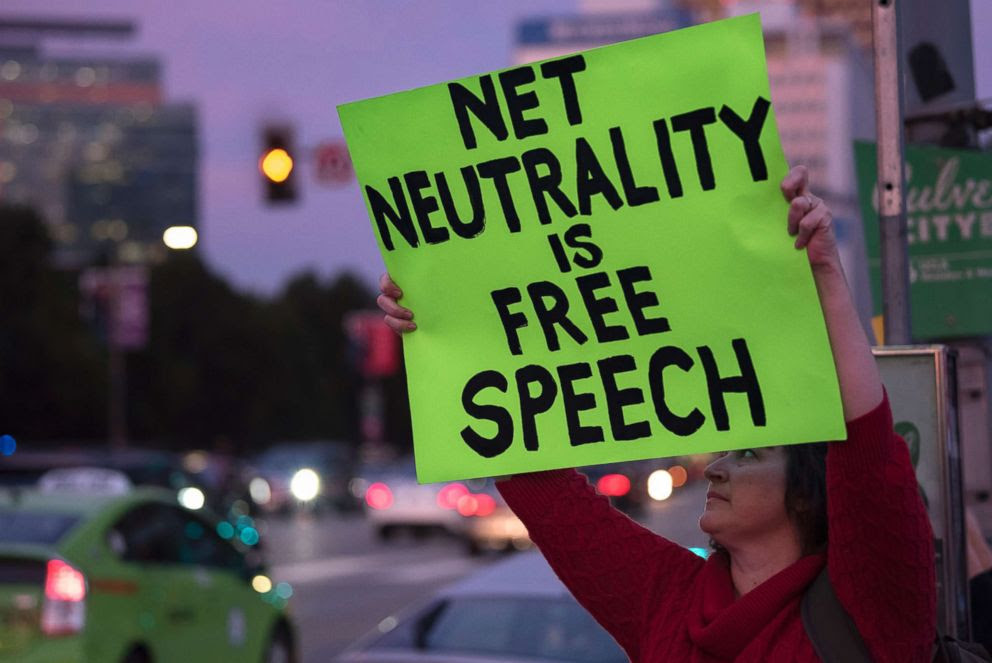 PHOTO: A supporter of net neutrality protests outside a Federal Building in Los Angeles, Nov. 28, 2017.