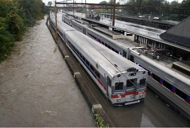 Two Southeastern Pennsylvania Transportation Authority trains sit in water on flooded tracks at Trenton train station Sunday, Aug. 28, 2011, in Trenton, N.J., as rains from Hurricane Irene are causing