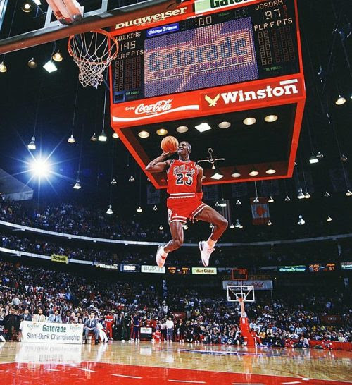 siphotos:<br /><br />Michael Jordan leaps from the free-throw line for a perfect-score dunk in the 1988 NBA Slam Dunk Contest. MJ turned 51 today. (Walter Iooss Jr./SI)<br />GALLERY: SI's 100 Best Michael Jordan Photos <br />