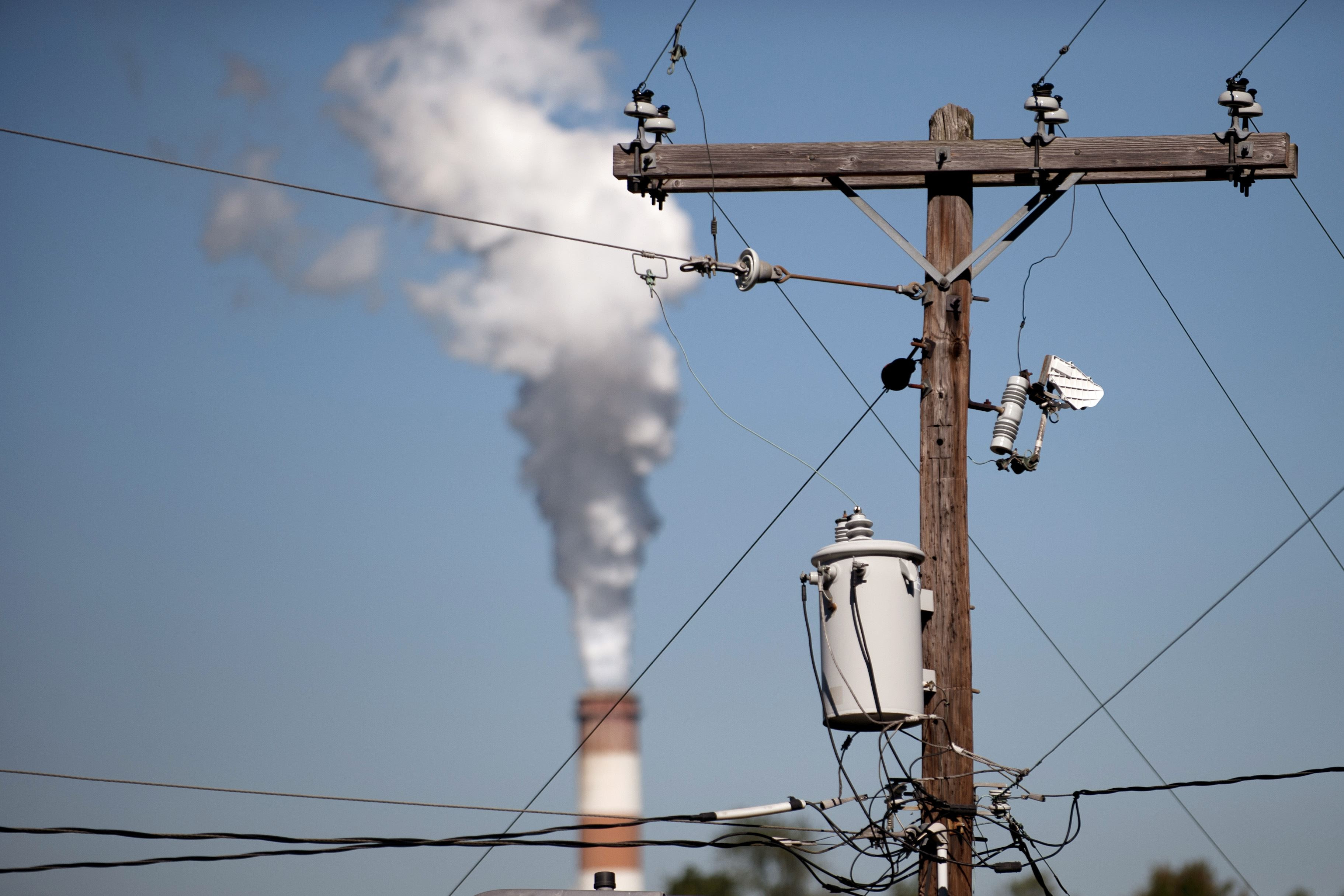 76537459 A plume of exhaust extends from the Mitchell Power Station, a coal-fired power plant in New Eagle, in September 2013. FirstEnergy Corp. closed the plant a month later, citing pressure from low natural gas prices and environmental regulations.