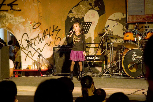 Young singer on stage