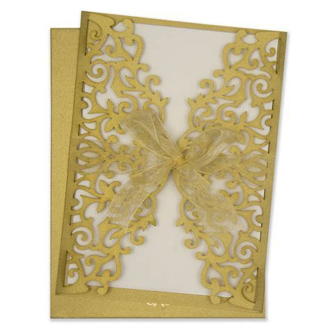 Wedding Invitation with laser cut floral motifs in golden
