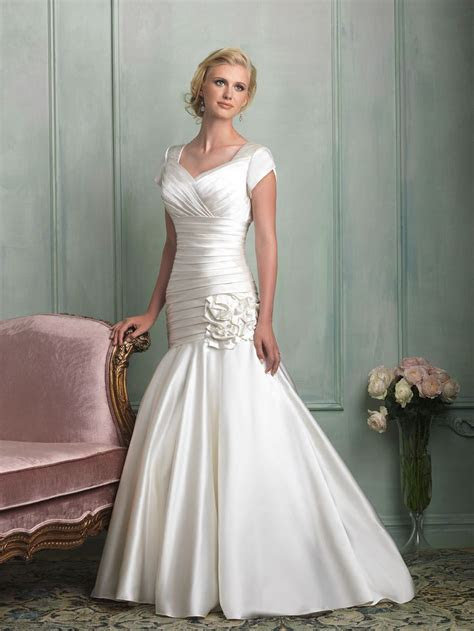 Ruched throughout the bodice, this satin mermaid gown