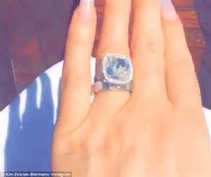 Kim Zolciak praises husband Kroy while flashing diamond